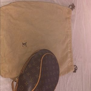 A Louis Vuitton bookbag  purse